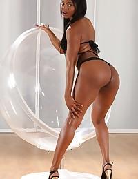 Stunning ebony babe loves to piss on camera photo #2
