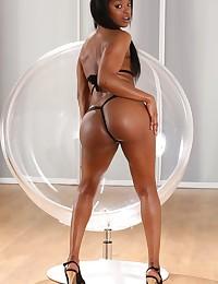 Stunning ebony babe loves to piss on camera photo #4