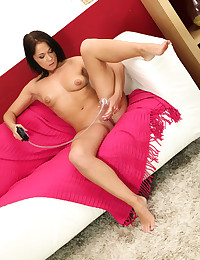 Brunette Angela teases her pussy with a dildo photo #8
